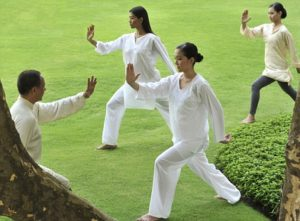 28 May 2009, Unknown --- A group of people doing Tai Chi outdoors --- Image by © Luca Tettoni/Robert Harding World Imagery/Corbis